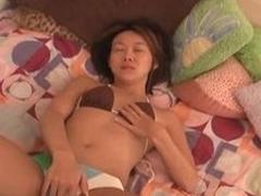 Teen Asian in a bikini masturbates solo