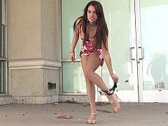 Fashionable brunette flashing in public