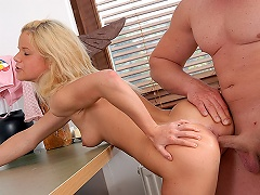 A blond teenage angel is sitting on top of a desk. A guy who is next...