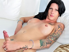 Tattooed ladyboy shows her gazoo a& wang and this babe enjoys it!...