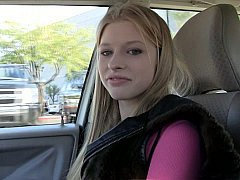 Enchanting college girl widening on camera