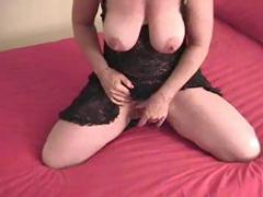 Busty mature with a very large love button is masturbating solo masturbation
