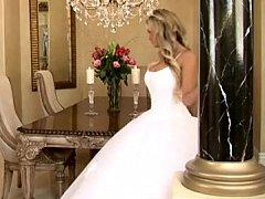 Bride in charming wedding dress widening legs