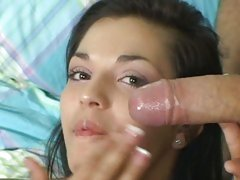 Teen doxy Alicia Angel takes a big load across the face and smiles