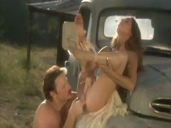 Sexy brunette riding acquires her twat fucked on the old truck next to the barn