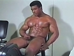 Sexy black homo getting his large rod hard whilst exercising...