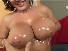 Large titty adult movie actress Claire Dames plays with her biggest tits and finger...