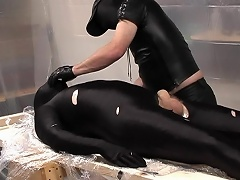 Masked and in black latex, those 2 gorgeous dads are really...