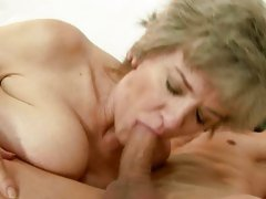Sexual granny spreads her lips round a unyielding fuck pole