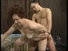 German raven-haired granny gets a younger pecker to fuck her hardcore