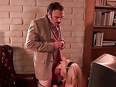 Sluty blonde with huge funbags gives blowjob to nerdy hunk in office