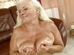 Vintage doxy Judi taking huge cum load all over tits
