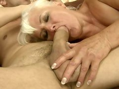 Judi is a lustful granny working cock with throat