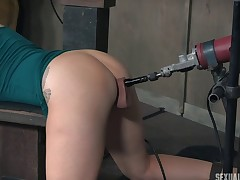 Babe fucked by a machine while engulfing an erected prick
