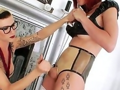 Abrupt haired tall tattooed whorish shemale Danni Daniels with step Bristols together with disputable glasses enjoys pinpointing ass of her petite redhead tranny ally Eva Lin nigh stockings.
