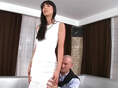 A hot black haired bitch is possessions fucked by a big in the buff dude