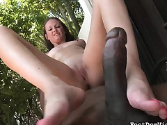 Hailey Young sits on a dark dude with the addition of gives him a saucy footjob