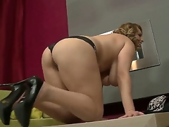 Appetizing and palatable woman with large natural titties gets naked and masturbates