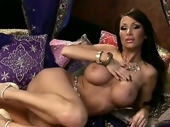 Spend great time looking at Sandee Westgate having unforgettable masturbation in this scene! Busty babe becomes nude before taking dildo and stuffing snatch by it.