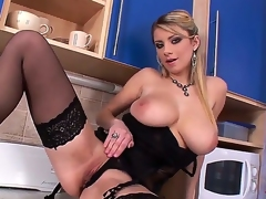 Sensual and arousing blonde honey in black underware and heels Katarina enjoys in stripping, teasing and playing with her big boobs as well as stretching her shaved taco in kitchen
