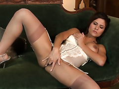 Danni Gee with gigantic hooters and clean beaver touches her wet spot and breasts playfully