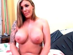 Voluptuous tattooed angel has incredible large melons