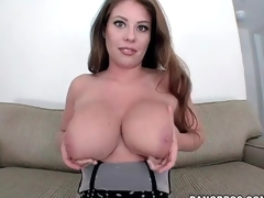 Large natural tits coated in slippery oil