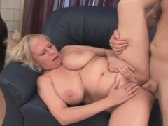 Plump granny with big tits pleasuring younger man