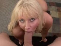 Mature tow-headed with massive jugs gives sensual blowjob