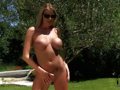 Danielle Maye is a big breasted busty goddess. She is proud of her perfect body and strips out of her pin bikini in a playful manner. Watch busty heartbreaker in shades strip naked in the sun