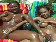 Tempting naughty Ariel with hot body and her dark girlfriend with big juicy gazongas in bikinis enjoys touching each other by the pool and share meaty pecker in point of view