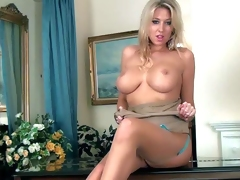 Lexi Lowe is a glamorously gorgeous blonde breathtaker with big perfect boobs. She shows off her hooters before she opens her legs and makes her finger disappear in her wet constricted pink aperture