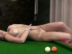 Horny and aroused brunette milf LaTaya Roxx with large honkers enjoys in spreading her legs and playing with some pool balls ont this guy pool table in front of the cam
