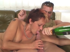 Granny banged by two young black and white studs