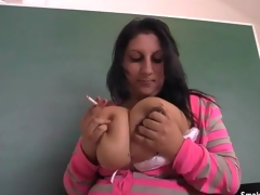 Fat girl smokes and caresses her tits