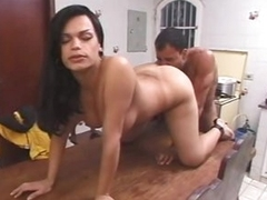 Busty shemale oral sex in kitchen