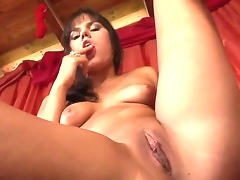 Brunette Rosee takes dildo up her love box after sexy striptease