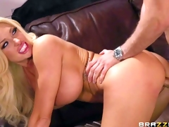 Summer Brielle is a stunningly beautiful blonde that turns man on with the help of her amazing huge boobs. She sucks his rod and then bows over to take his pole in her pink hole from behind