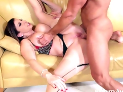 Heavy chested milf Sara Jay in sexy lingerie and garter thong gets a full service from her muscled and tanned neighbor Johnny Castle on her ottoman in the living room