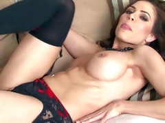 Erika Jordan is a big boobed seductress in black nylons. She poses topless and shows off her sexy jugs before she removes her revealing panties. Then she touches her snatch and exposes her bare butt