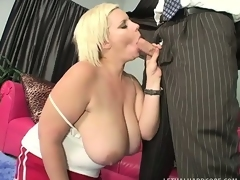 Naughty chunky slut gives a mean boob job with her gigantic tits