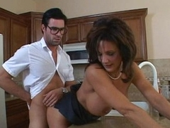 Hot Mama Deauxma is bent over in the kitchen for a serving of cock