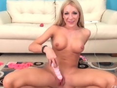 Tattooed blonde with a shaved pussy plays solo