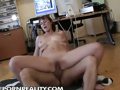 Redhead chick with juicy melons lets man insert his meat stick in her mouth