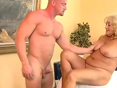 Busty and chunky granny fucked by a shaved guy.