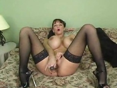 Giant tits babe in lipstick plays with vagina