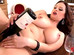 Enormous chested Sirale masturbates with vine bottle