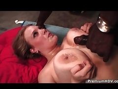 Chubby minx with massive tits enjoys interracial sex