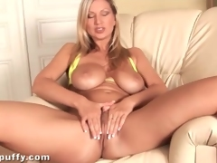 Bikini looks incredible on big tits blonde girl
