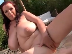 Bulky chick with big hot tits in the hot tub